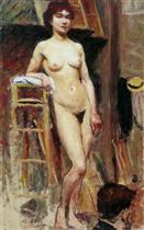 Naked woman Standing in a Workshop