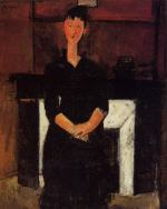 Woman Seated in front of a Fireplace