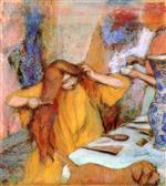 Woman in a Yellow Robe Combing Her Hair