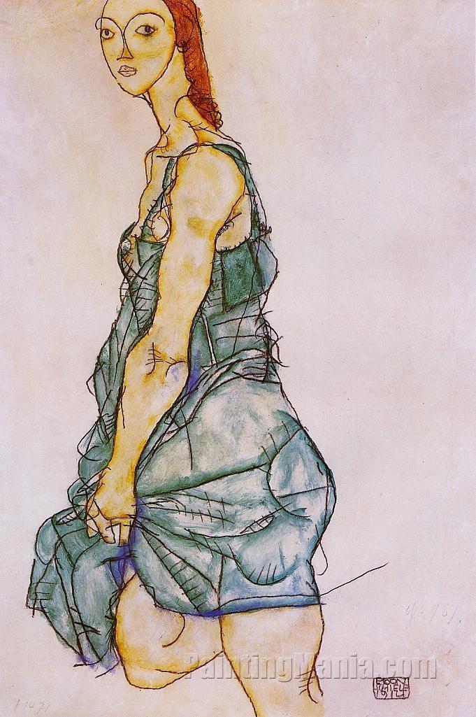 Standing Woman in a Green Skirt