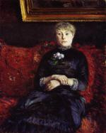 Woman Sitting on a Red-Flowered Sofa