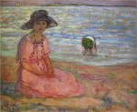 A girl in a pink robe by the sea