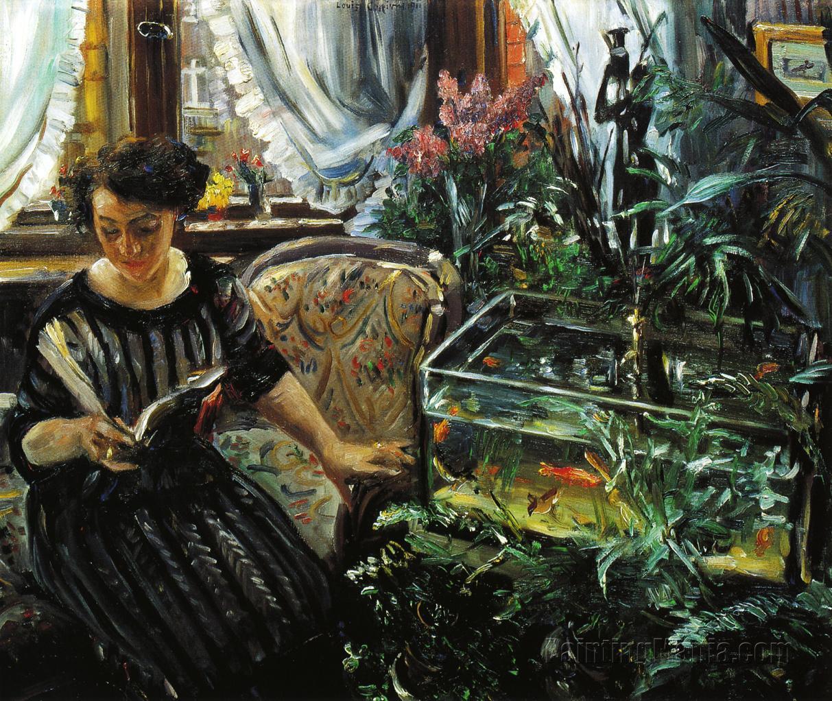 Woman by a Goldfish Tank